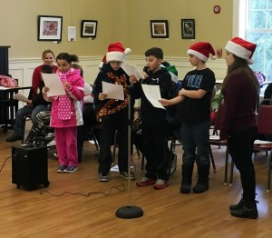 Students caroling at the Senior Center.