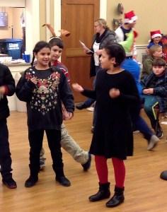 Students caroling at the Senior Center