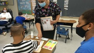 Teacher is assisting student