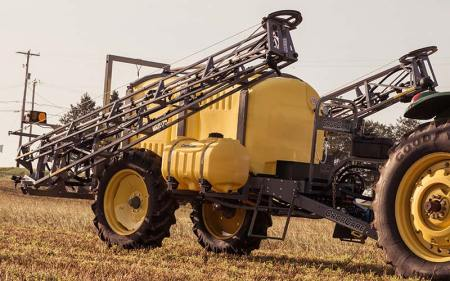 yellow crop care tractor