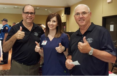 Bob Connell owner of KFFB, Erica Caraway first Cash winner and Dale Gardner take time for a Picture.
