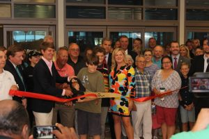 This was the ribbon cutting for the Quiet Room at Myrtle Beach Airport. I got the ribbon sections in mid-air, just after the cut.