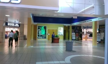 South end of the mall. This used to be one (or more?) large anchor stores. The double doors with the RFID security pad lead to the second floor Systemax offices.
