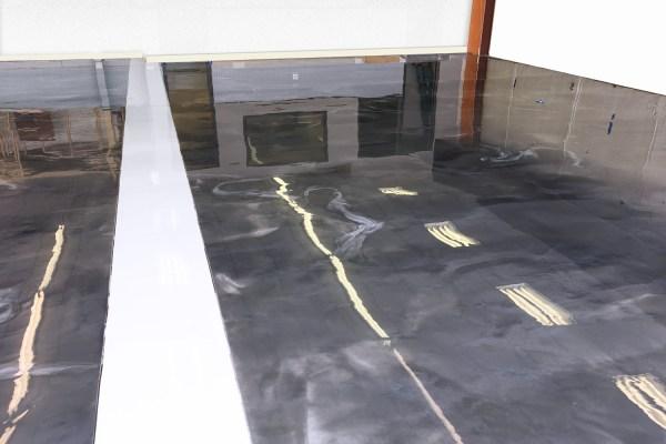 A dark gray and white metallic epoxy floor