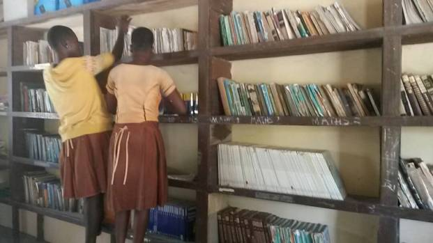 Kopeyia students helping to straighten up the library