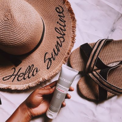 altruist-sunscreen-review-beach-essentials-hat-slippers-straw-bag-flatlay-pink-preset-darkroom-affordable-sunscreens-nigeria-honeyricci-khairahscorner