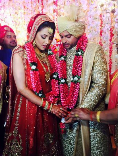 Indian cricketer ‪Suresh Raina‬ ties the knot with his childhood friend Priyanka.