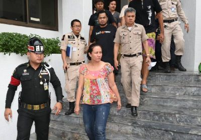 Nuttigar Woratunyawit escorted to prison April 29, 2016, after bail was denied by a military court in Bangkok.