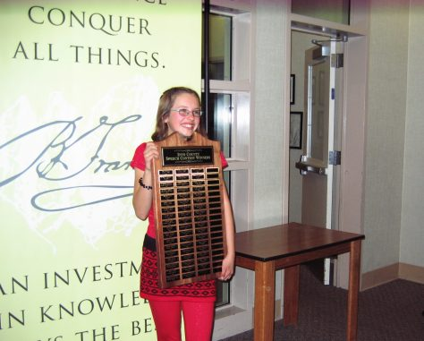 1st place finisher Naiya Warren holding the winners plaque which has the names of the speech contest winners back to 1960. Owens Valley School will display the plaque until the 2016 speech contest