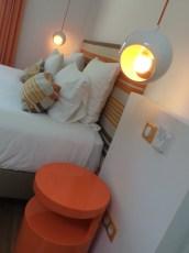 a orange spotlight by bed