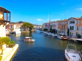 view of colourful houses in port grimaud on the water