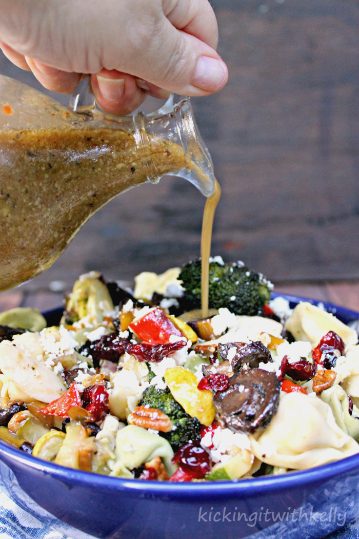 Roasted Summer Vegetable Tortellini Pasta Salad pouring