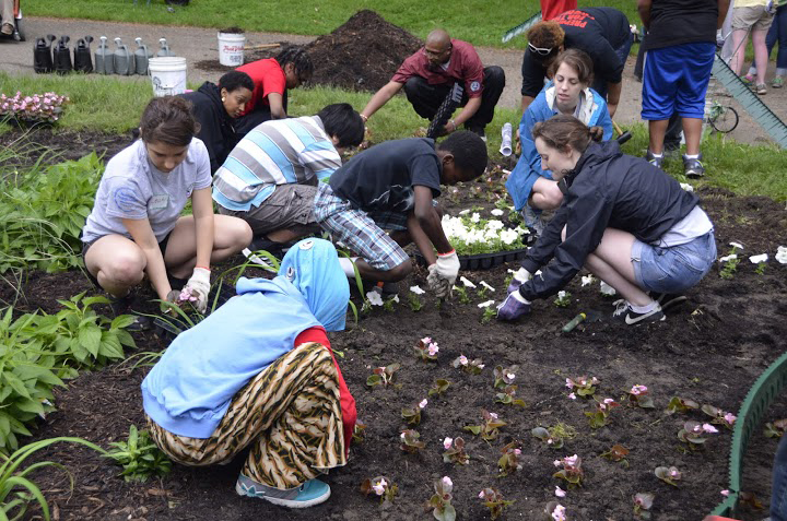 Arsenal Elementary and Middle students planting flowers in the park. Photo courtesy Lawrenceville United.