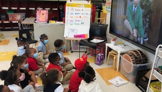 """Photo of students watching """"Mister Rogers' Neighborhood"""" courtesy of the Fred Rogers Center."""