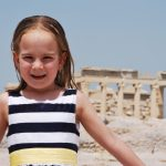 Kid posing infront of Acropolis KidsLoveGreece.com