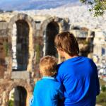 father and son staring Herodion odeon from Acropolis