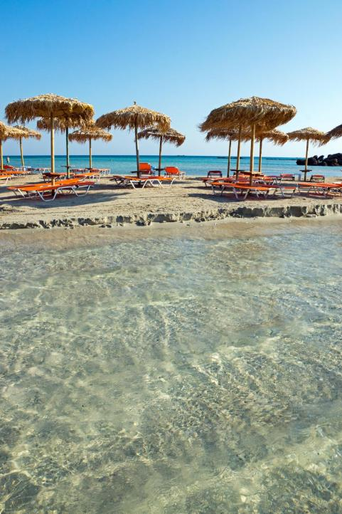Sandy beach umbrellas and sunbeds in Elafonisi Chania