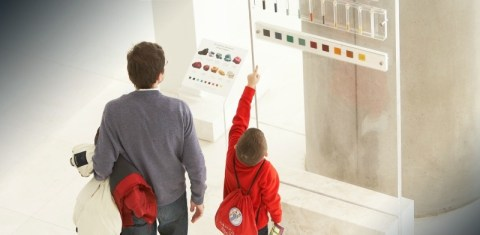 dad with kid in Acropolis museum