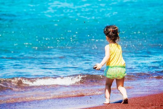 girl on the red beach Santorini