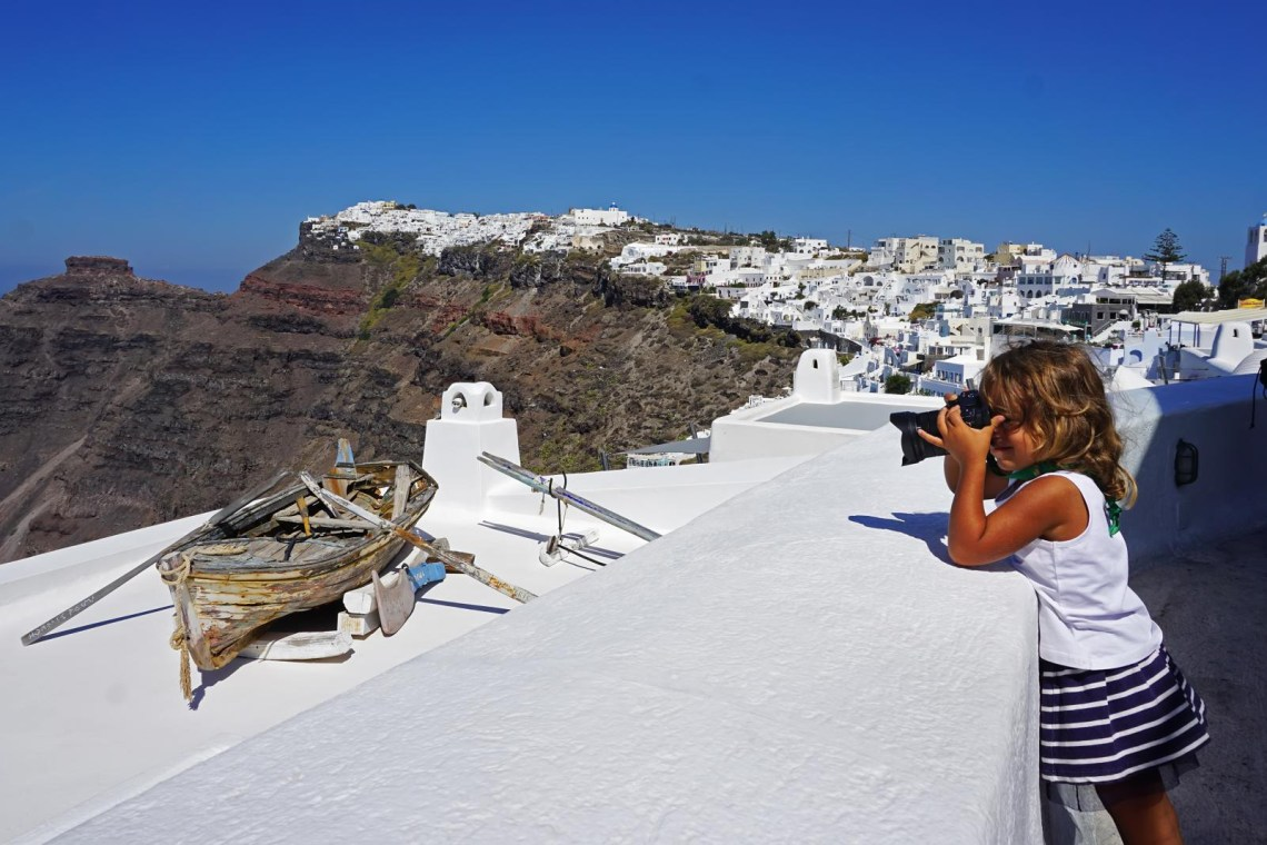 girl shooting photos in Santorini