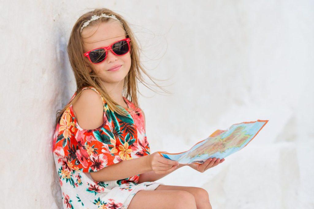 Girl holding a map Greek islands DP