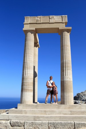 Family posing at Hellenistic stoa of Lindos Acropolis, Rhodes, Greece