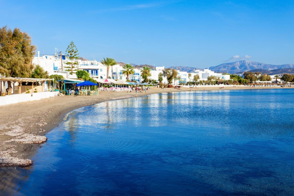 quite beach and village at Naxos island
