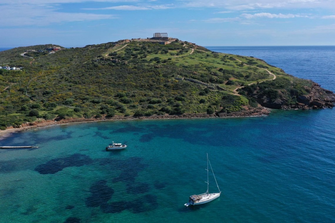 cape sounio sea boats and temple of Poseidon
