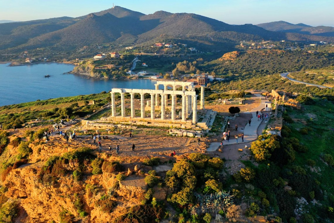 temple of poseidon at cape Sounio with visitors