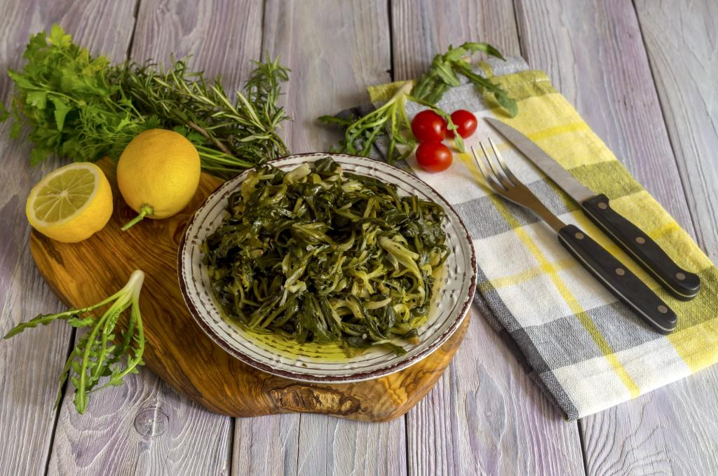 A dish of rare boiled grass stamnagathi bolied greens horta DP-min-1