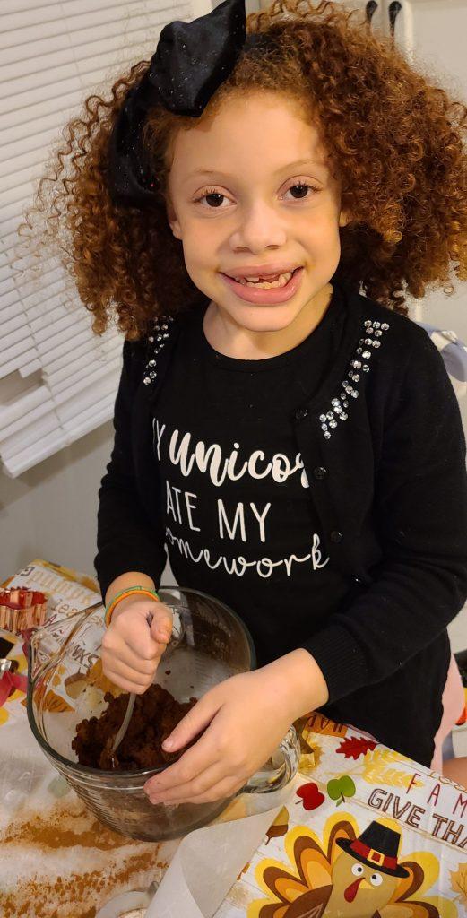 little girl mixing