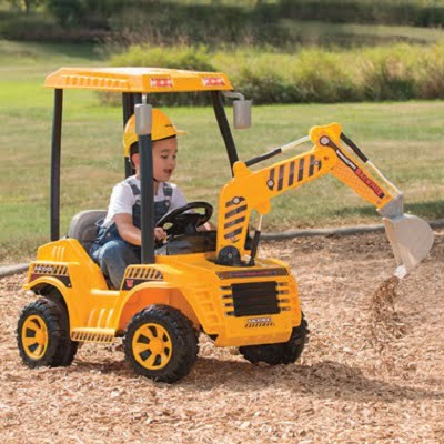 The Motorized Dirt Digger - A ride-on motorized backhoe that enables a child to dig sand and dirt just like the real thing