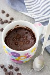 Chocolate mug cake in a flower mug with chocolate chips