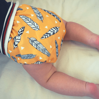 Baby in Reusable Cloth Pocket Nappy Feather