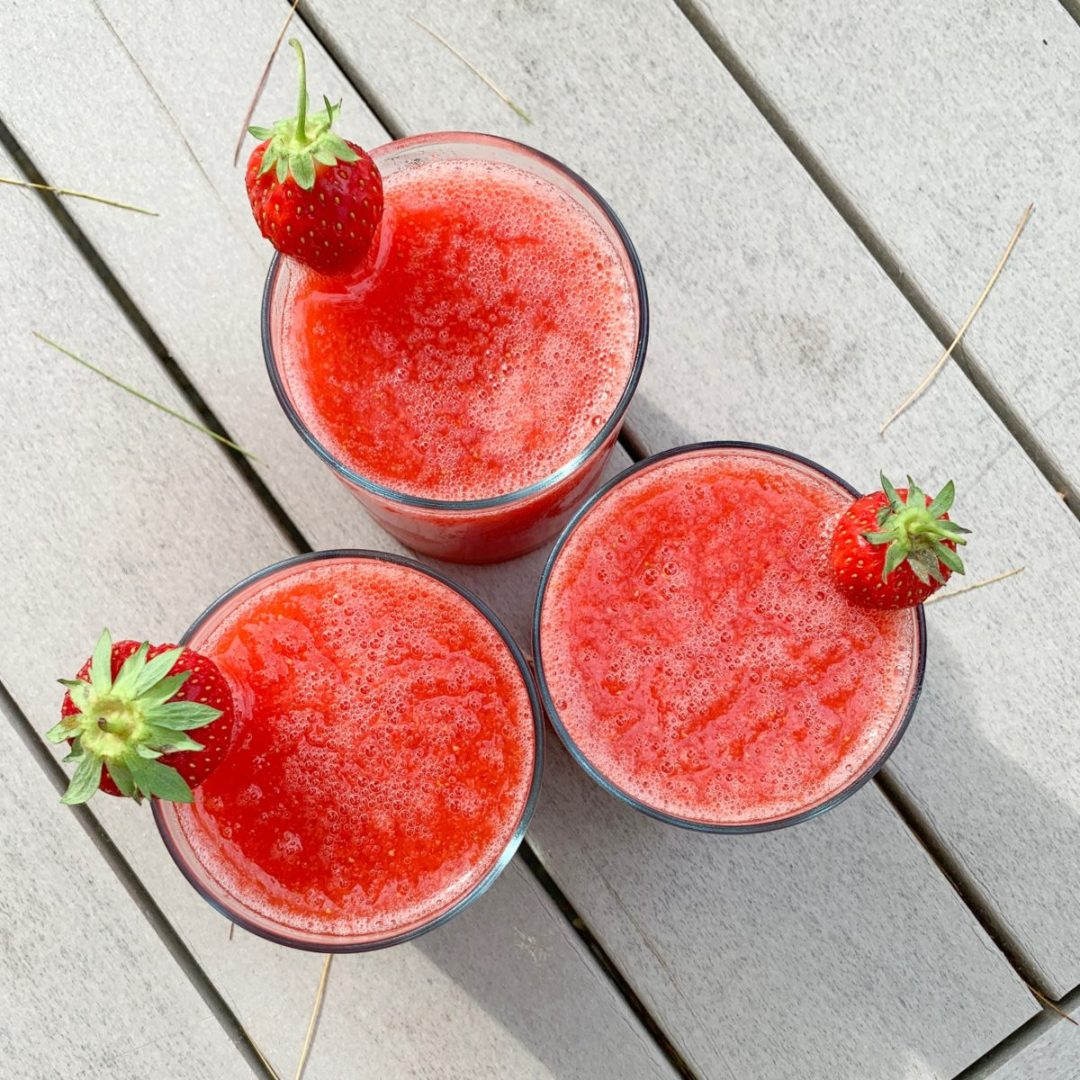 frozen strawberry margarita on the picnic table