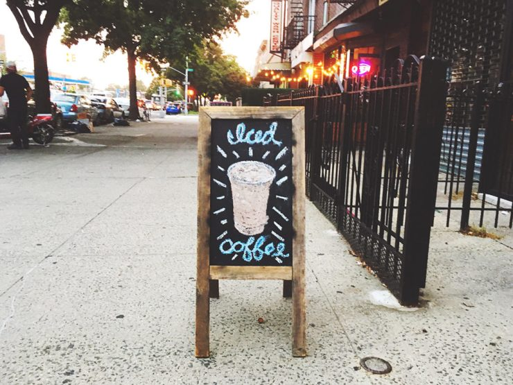 iced coffee shop sign outside of shop in brooklyn