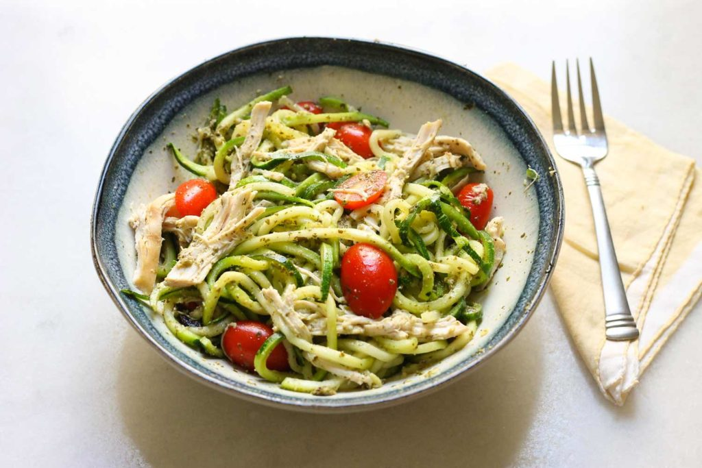 rotisserie chicken with zoodles pesto and tomatoes