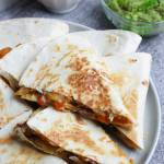 chicken fajita quesadilla slices on a plate