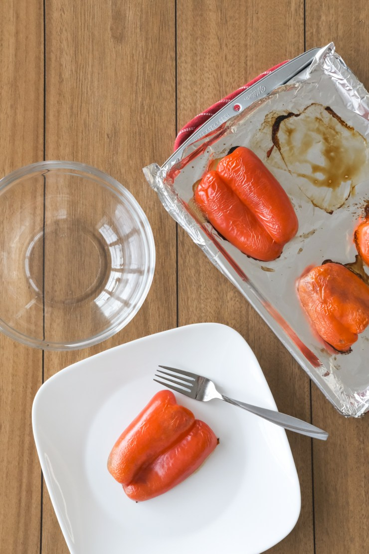 removing roasted red peppers from sheet pan to skin