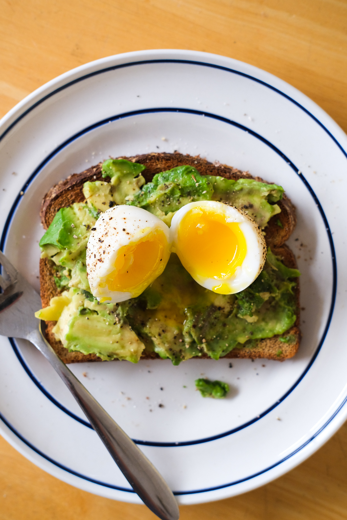 avocado toast with soft boiled egg cut open