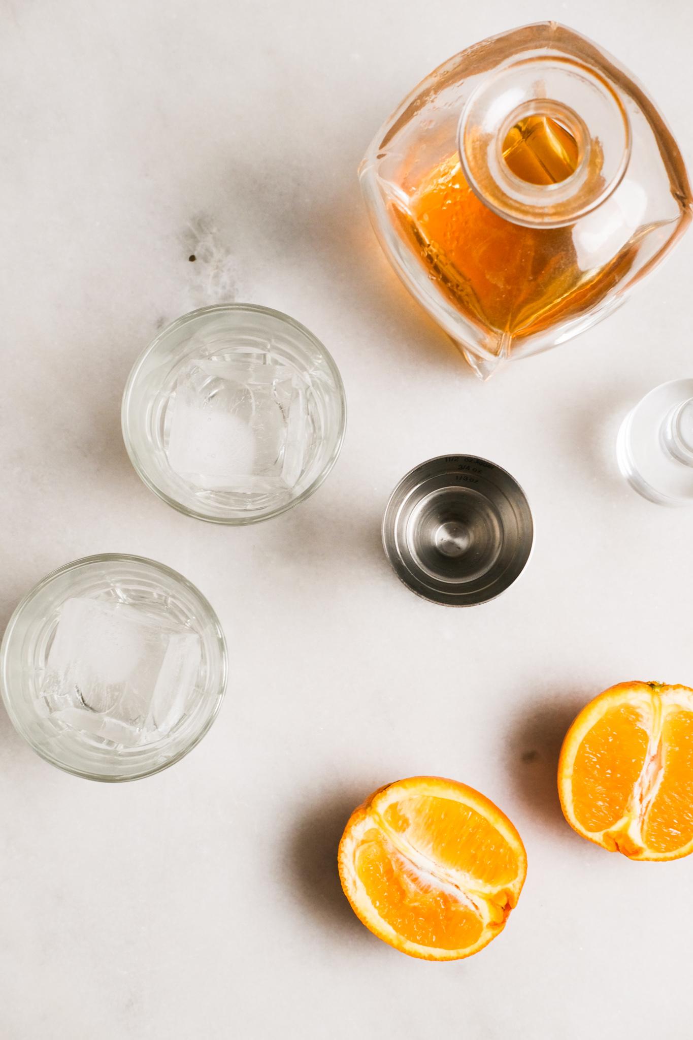 getting prepared to make an orange whiskey sour recipe