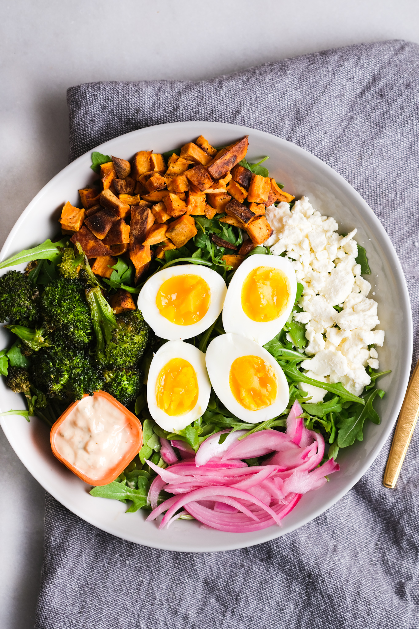 arugula lunch bowl with colorful ingredients