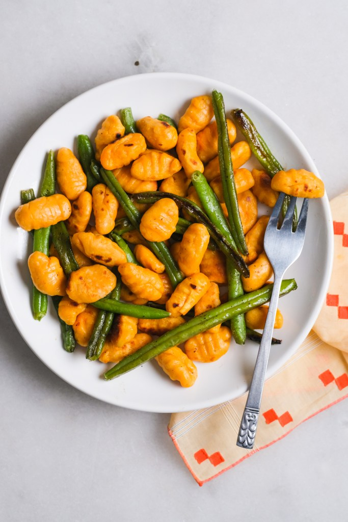 plate of sweet potato gnocchi with green beans