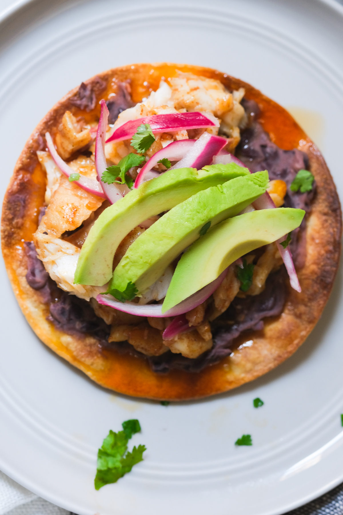 tostada with refried black beans and toppings