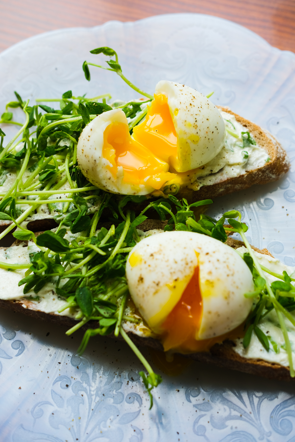 jammy eggs on toast with sprouts and chive cream cheese