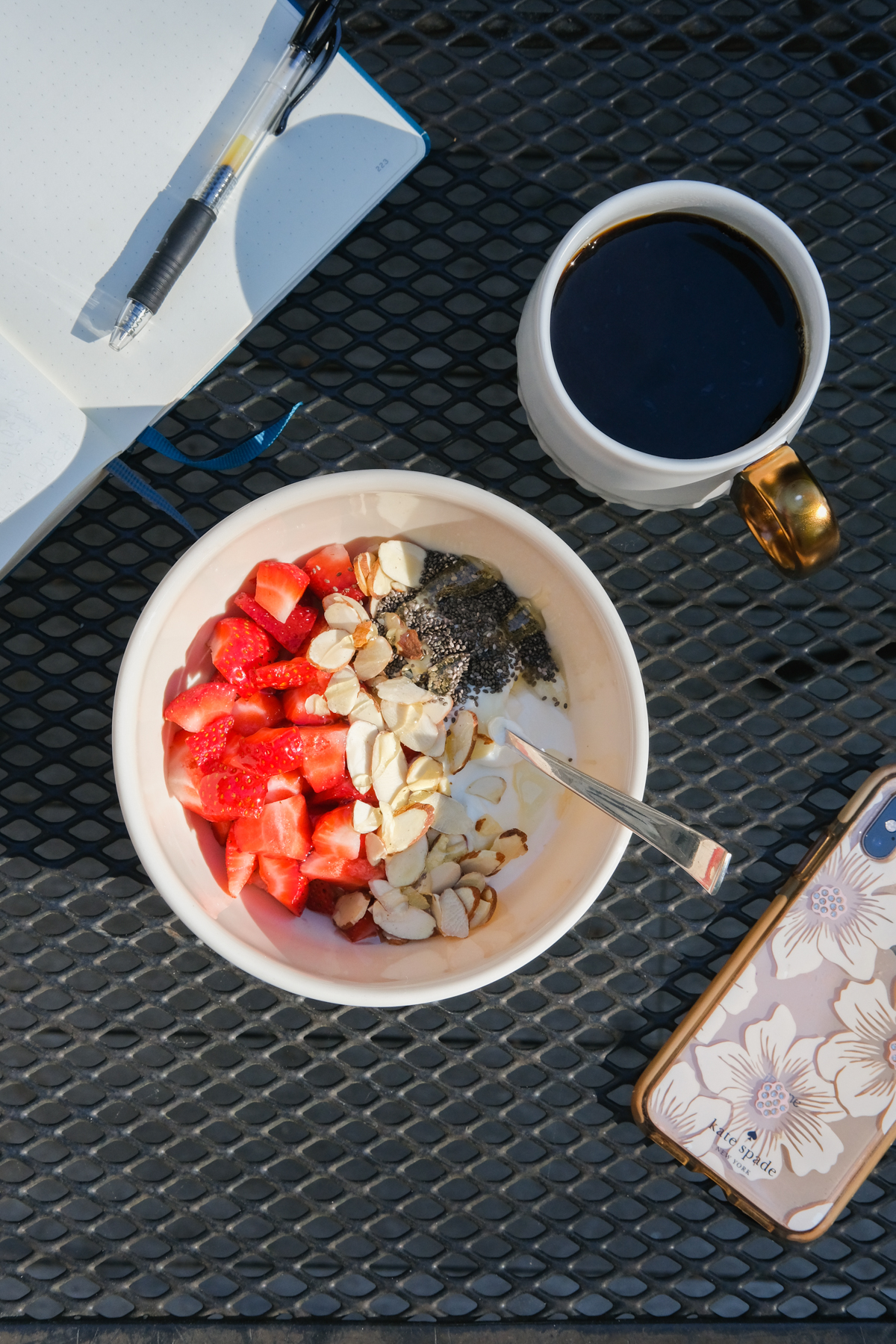 strawberries in a greek yogurt bowl on the deck