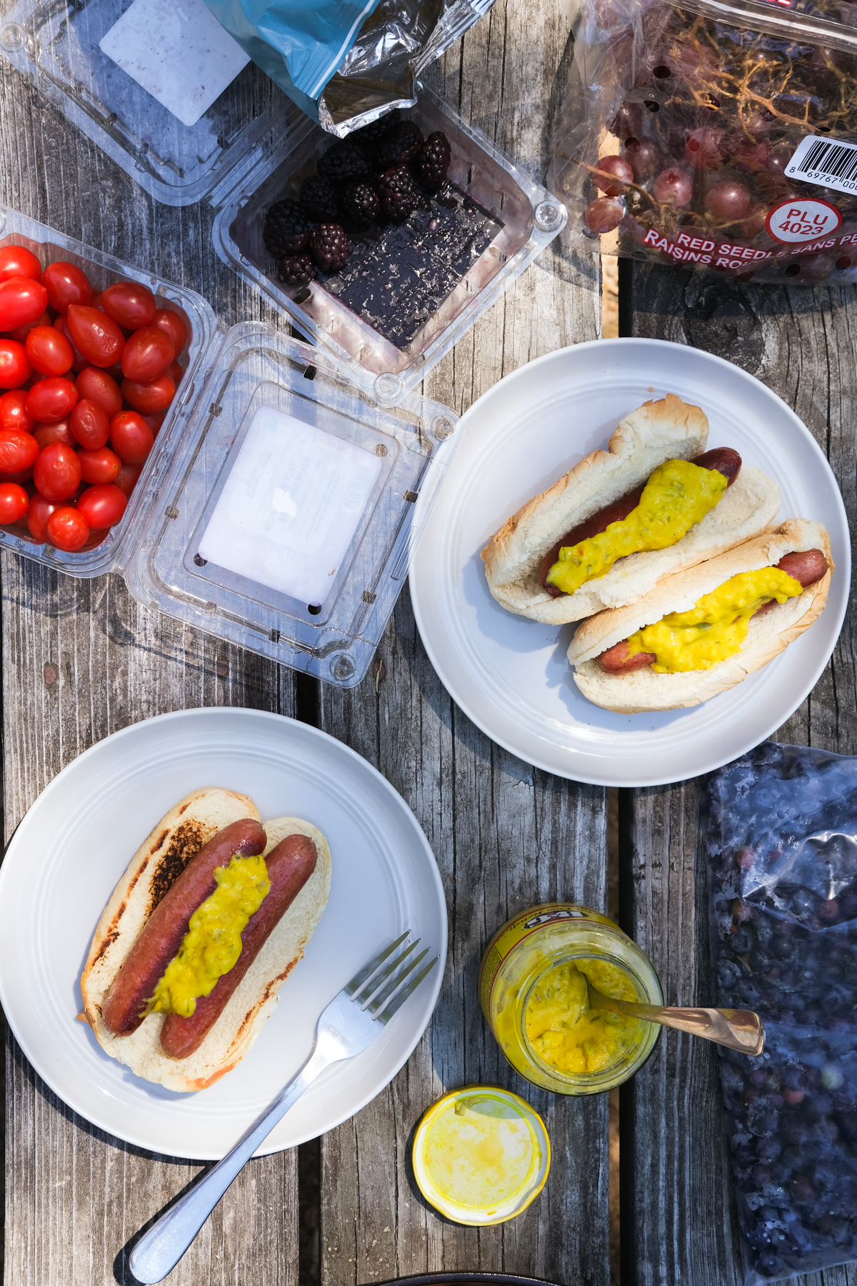hot dogs with hot dog relish and fruits with lunch