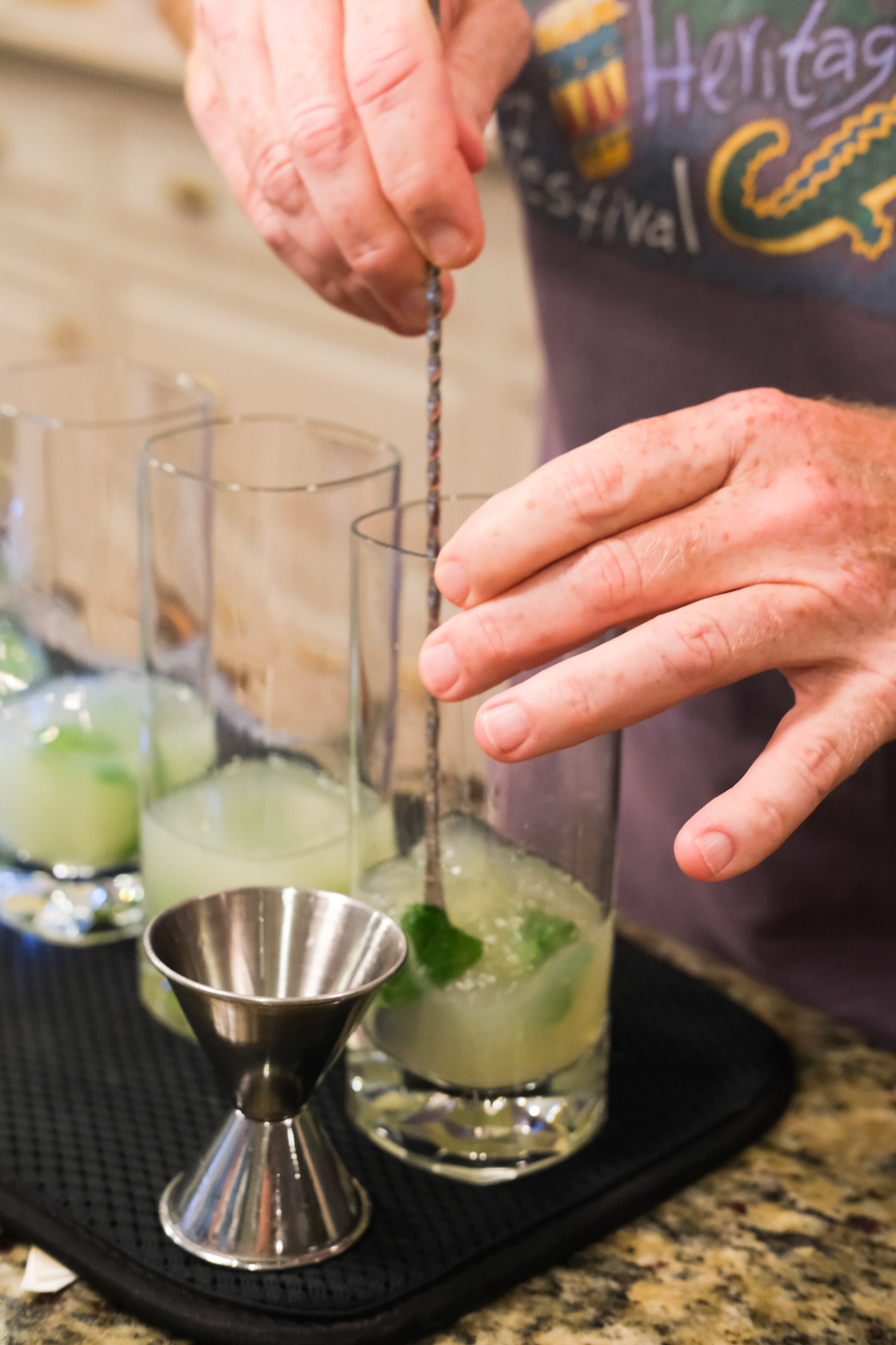 stirring the liquor for mojitos