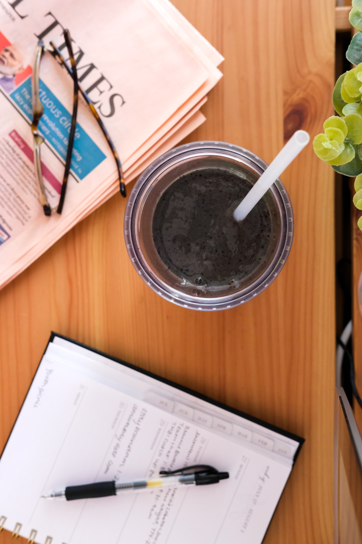 blueberry superfood smoothie on a desk