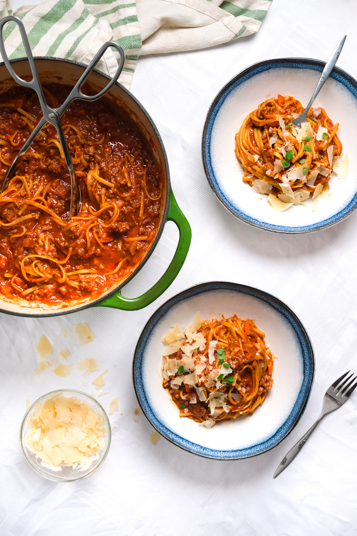 one pot bolognese filling bowls with shredded cheese